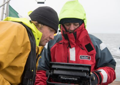 Johan Peterson is the new crew member.  He is the one peering round the chart plotter.  I'll try to get a portrait that the fans will like!  (I've read David's blog.)